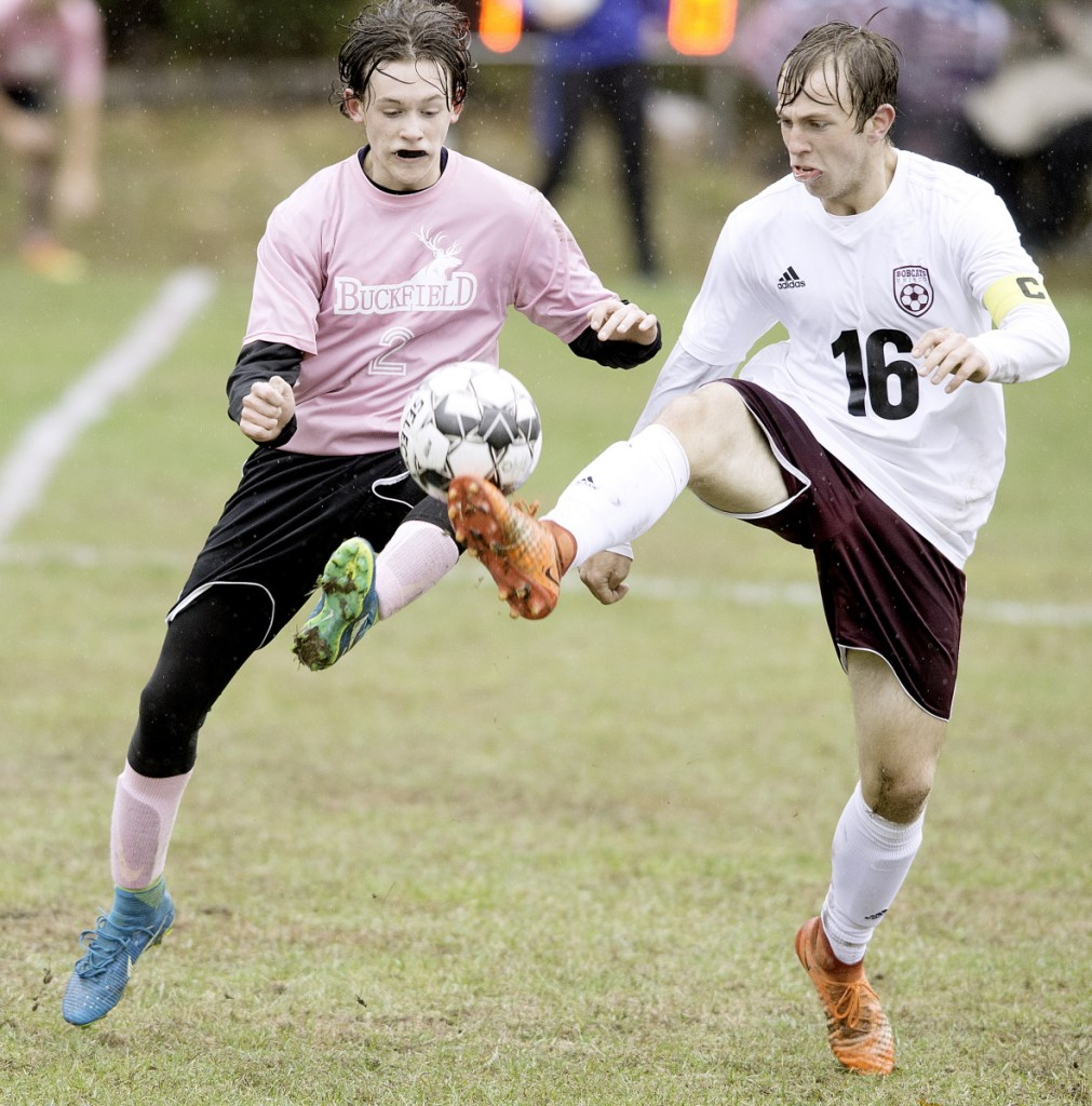 Buckfield's Elijah Chasse, left, and Ford Strout of Richmond compete for the ball during the first half of a Class D South quarterfinal game Tuesday in Buckfield.