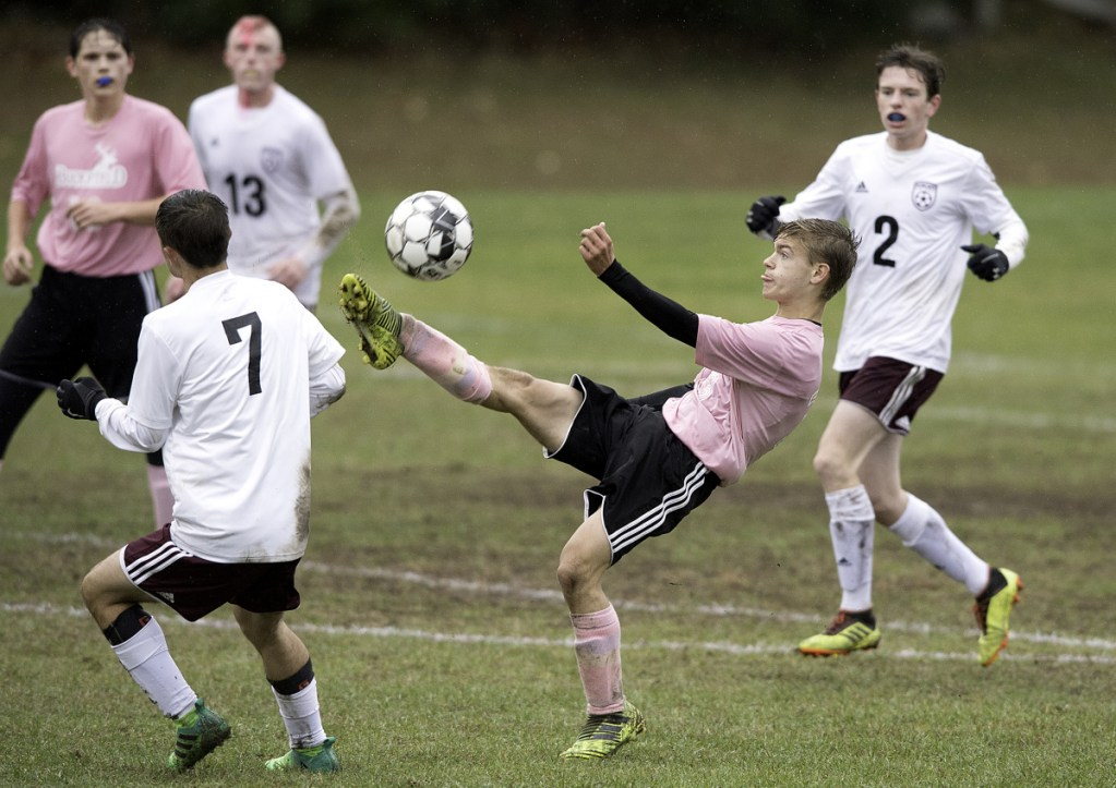 Buckfield's Victor Verrill bicycle kicks the ball against Richmond during Tuesday's Class D South quarterfinal game in Buckfield.