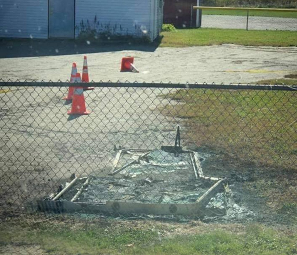 Two teenage boys have been charged after a police investigation linked them to a fire that destroyed a portable outhouse Sunday at Houdlette Field in Richmond.