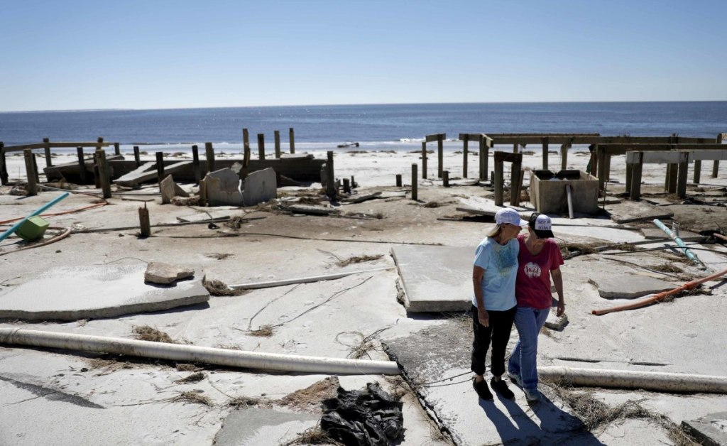 Joy Hutchinson, left, is comforted by her daughter Jessica Hutchinson after finding her home swept away from hurricane Michael in Mexico Beach, Fla.