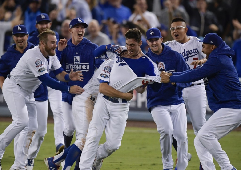 Cody Bellinger celebrates after hitting a walk-off hit during the 13th inning of Game 4 Tuesday night in Los Angeles. The Dodgers won 2-1 to tie the series with Milwaukee at 2-2. (AP Photo/Mark J. Terrill)