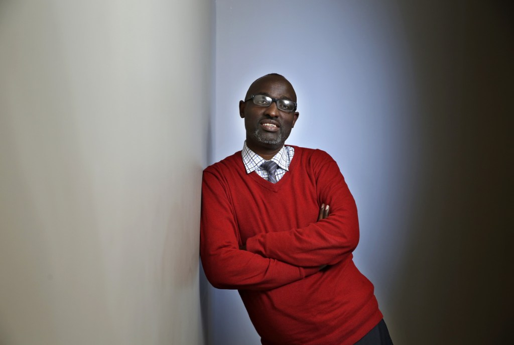 """Claude Rwaganje, executive director of Prosperity Maine, a Portland nonprofit, says he is cautiously optimistic about whoever succeeds Gov. Paul LePage in office. """"The last eight years haven't been really great"""" for Maine's immigrants, he says."""