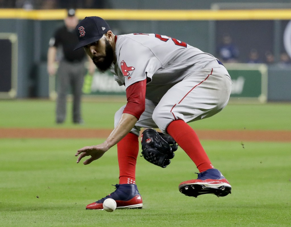 Boston pitcher David Price fields a ball hit by the Astros' Jake Marisnick during the fifth inning in Game 5 of the ALCS Thursday in Houston. Marisnick was out at first. (AP Photo/Frank Franklin II)