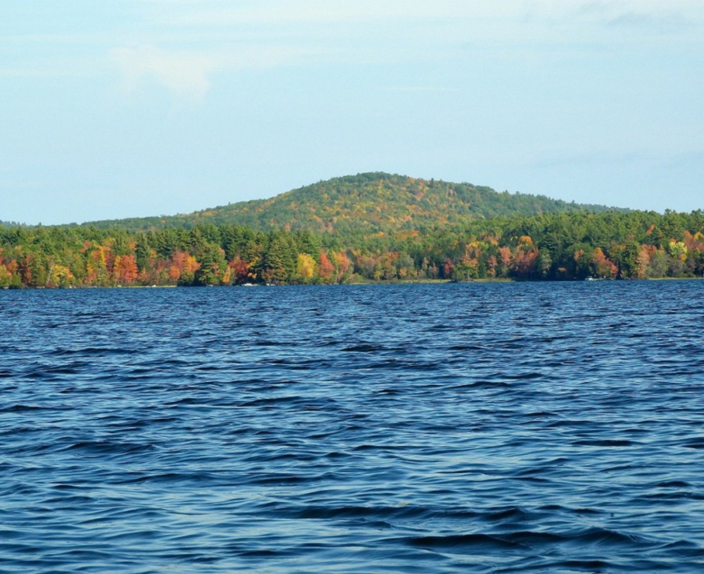 An amazing view looking north to Oak Hill in Fayette from Pocasset Lake. Oak Hill just rises out of the forest. Michael Perry photo