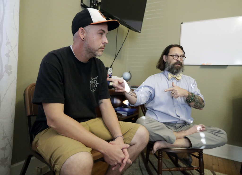 Tim Nolen, left, participates in a relapse prevention group session with counselor Bob Benson, right, at a treatment facility run by Buffalo Valley Inc. in Nashville, Tenn. Nolen has no health insurance coverage and his treatment for opioid addiction is funded by a grant program Congress approved in 2016 under the 21st Century Cures Act.