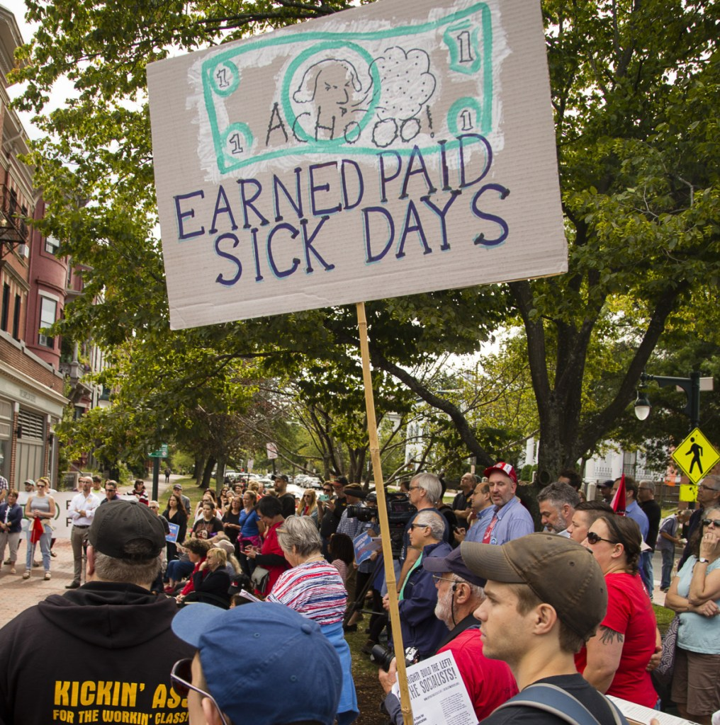 People rally in Longfellow Square last year during the launch of a campaign to require employers in Portland to provide earned sick days.