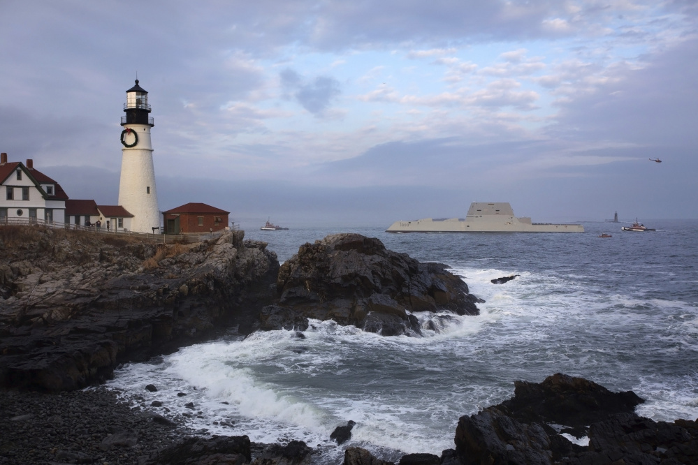 The U.S. Navy's new Zumwalt-class stealth destroyer passes Portland Head Light on its way to Portland Harbor in December 2015.