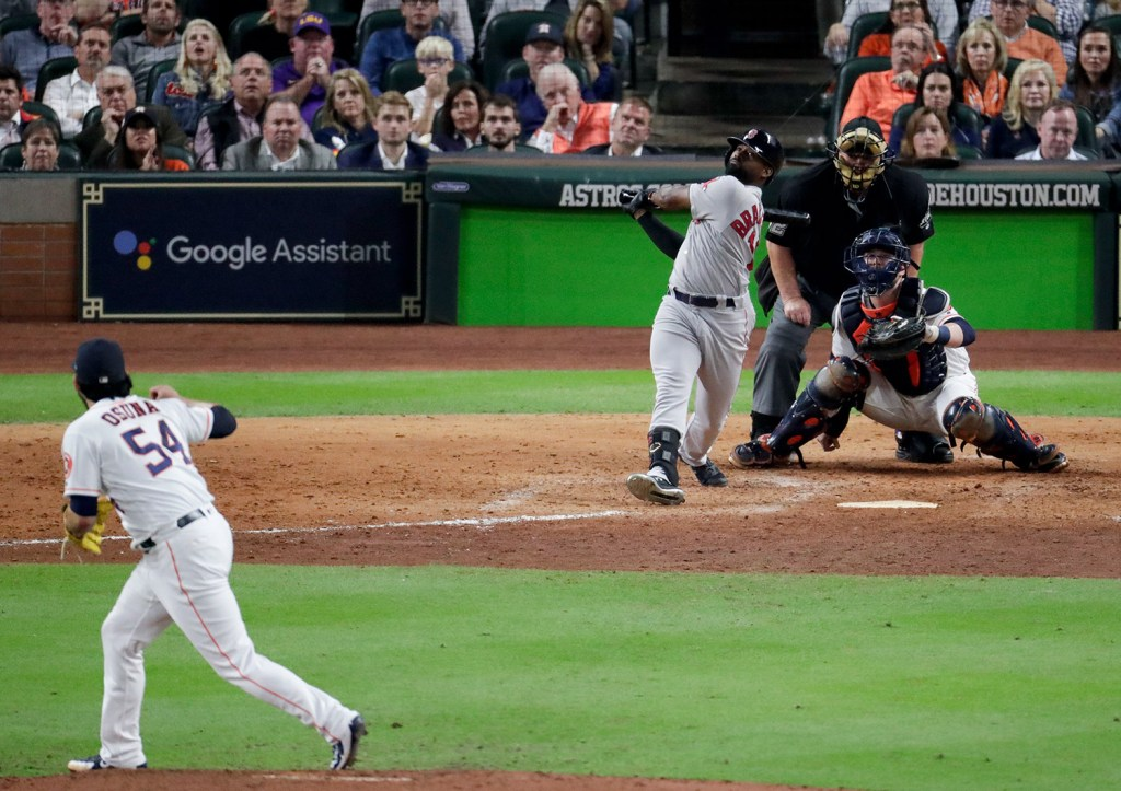 Boston's Jackie Bradley Jr. connects for a grand slam off Houston Astros relief pitcher Roberto Osuna in the eighth inning, breaking open Game 3 the American League Championship Series.