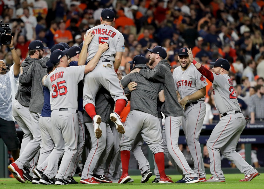 The Red Sox celebrate after winning the American League pennant with a 4-1 victory over the Houston Astros in Game 5 of the league championship series Thursday night in Houston.