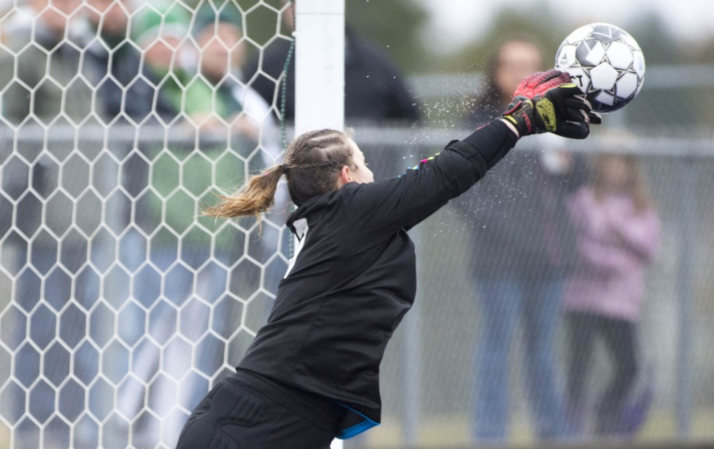 Fort Kent goalie Lyndsay Ouellette makes a save against Maranacook in the Class C girls state championship game Saturday at Hampden Academy.