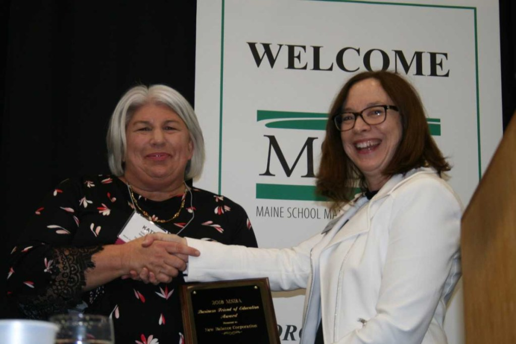 Katherine Foy Bartley, left, receives the Maine School Boards Association Business Friend of Education Award on Oct. 25 in Augusta from MSBA President Maureen King.