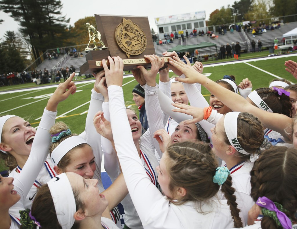 Winthrop celebrates its win over Spruce Mountain in the Class C field hockey state championship Saturday at Deering High School in Portland.