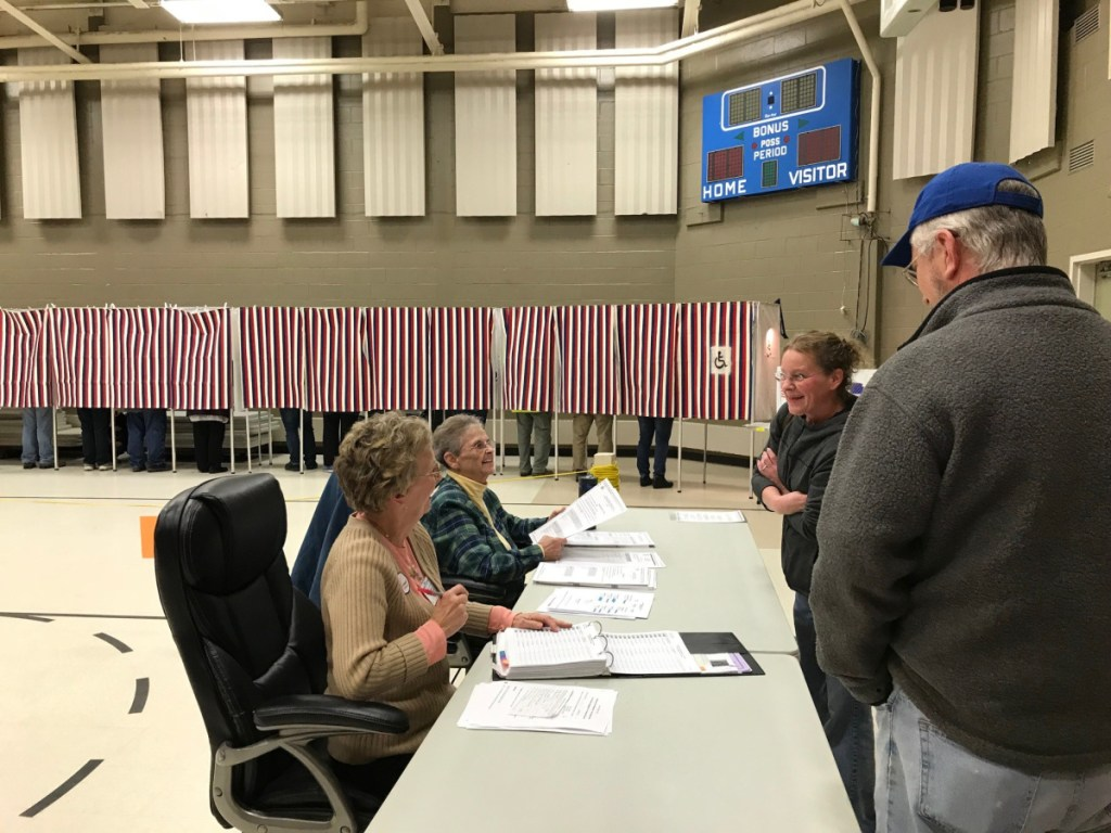 Fairfield election clerks Lynda Kinley and Patricia Shea hand out ballots to voters Tuesday during the election.