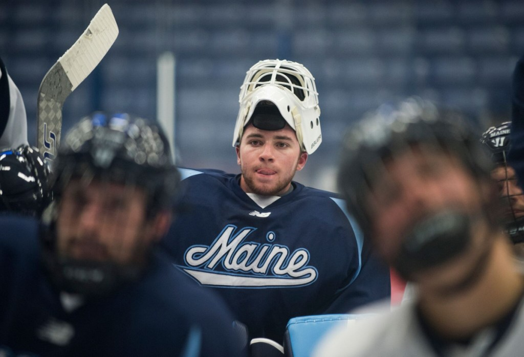 Maine sophomore goalie Jeremy Swayman listens to coaches during a break in practice at Alfond Arena in Orono earlier this season.