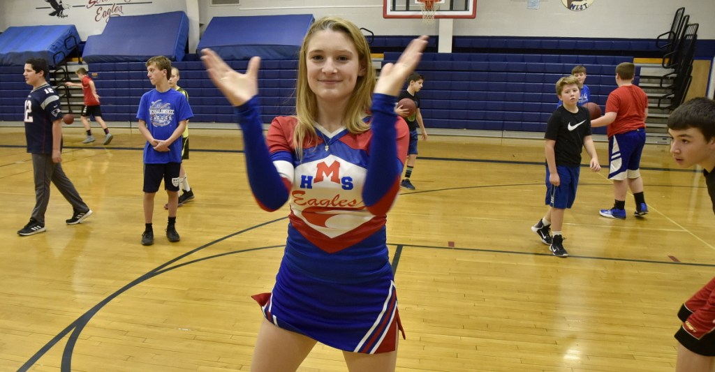 Messalonskee High School student Kaitlyn Berthiaume is the school's sole cheerleader. Berthiaume practices Thursday at the Oakland school gymnasium.