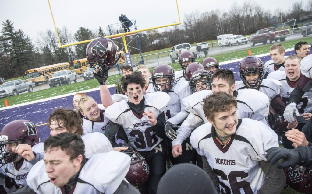 Staff photo by Michael G. Seamans   Nokomis celebrates its 13-6 win over Hermon in the Class C championship game Saturday at Hampden Academy.