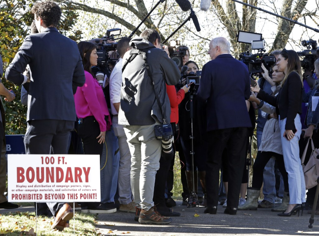 Former Gov. Phil Bredesen is interviewed past the 100-foot polling place boundary after voting Tuesday in Nashville, Tenn. Bredesen is running against Rep. Marsha Blackburn, R-Tenn., for the U.S. Senate.