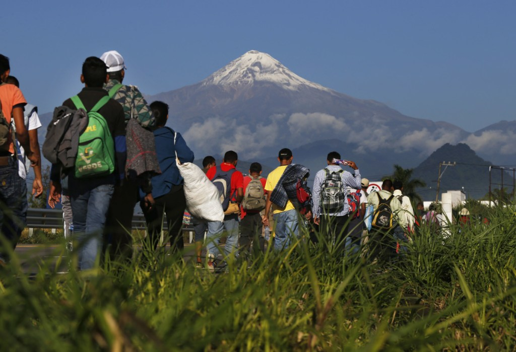 Central American migrants trek from Cordoba, Mexico on Monday. Mexico City officials are expecting as many as 5,500 migrants to arrive at the aid station.