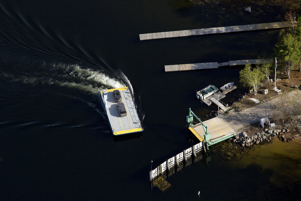 The ferry pulls up to the dock at Frye Island in Sebago Lake, in this aerial photo taken in 2015.