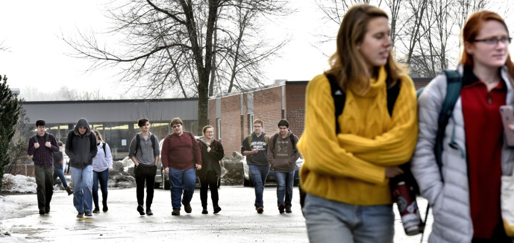Students leave Skowhegan Area High School at the end of the day on Monday. Police presence was added following a threat to the school posted on social media.