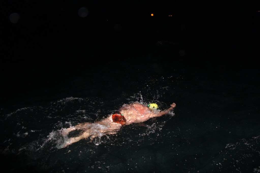 Contributed photo   Erik Rushton swims his leg at night as part of a team that swam the English Channel.