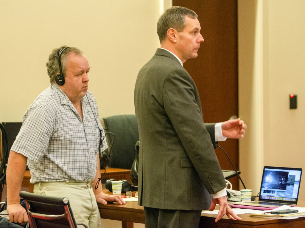 Andrew Bilodeau, left, watches as his attorney, Kevin Sullivan, participates in opening statements Wednesday during Bilodeau's jury trial at the Capital Judicial Center in Augusta.