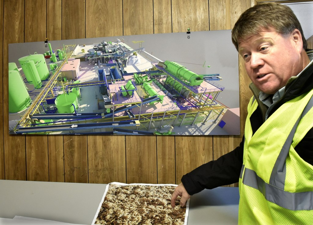 Fiberight Corp. CEO Craig Stuart-Paul shows some cellulose product that can be rendered and sold after being processed at the new solid waste processing and recycling facility under construction in Hampden on Thursday.