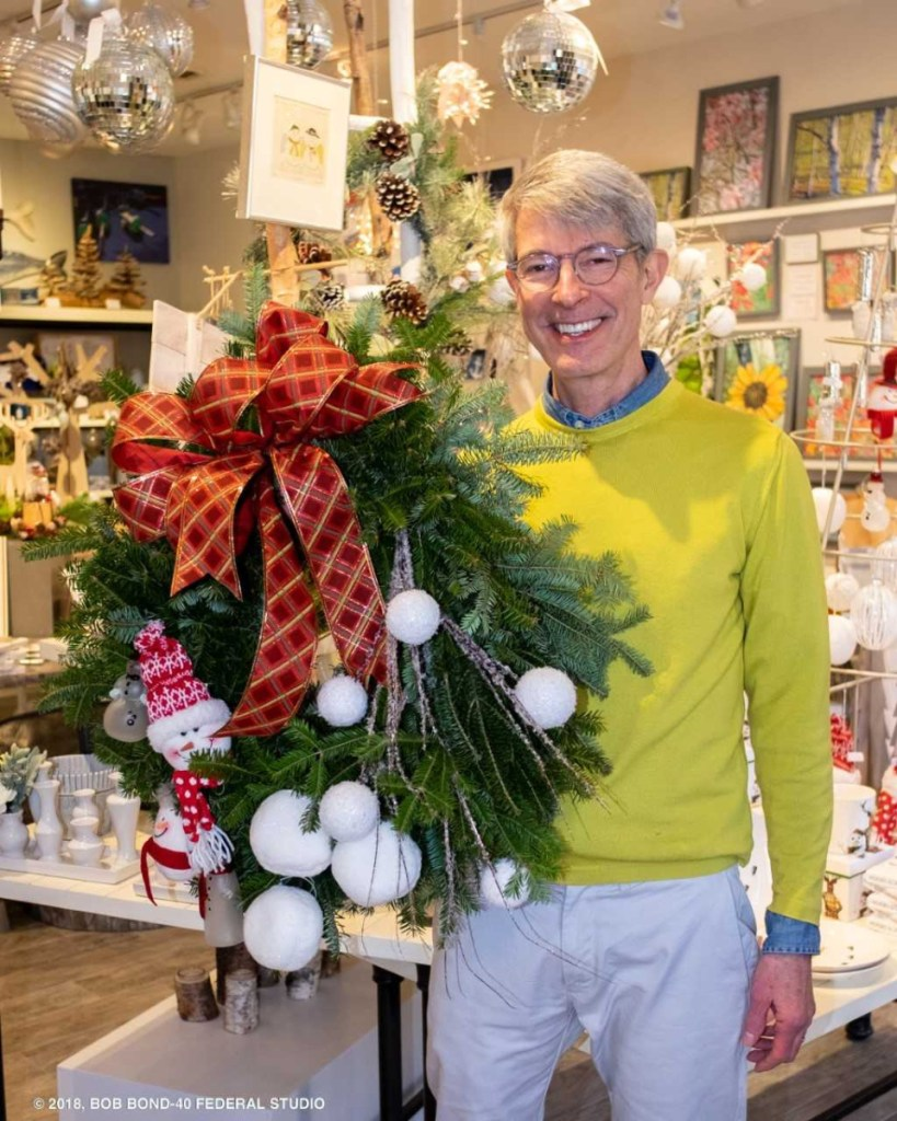 BIRCH Home Furnishings and Gifts co-owner Greg Uthoff shows off the wreath he designed and decorated as part of Wiscasset Holiday Marketfest's Wreaths Around the Holidays. The BIRCH wreath was chosen as the People's Choice winner at the close of Marketfest on Dec. 9.
