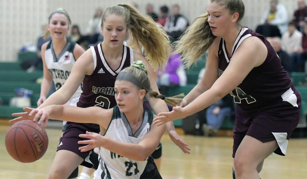 Winthrop's Layne Audet, center, passes beneath Richmond's defense during a Mountain Valley Conference game Wednesday in Winthrop.