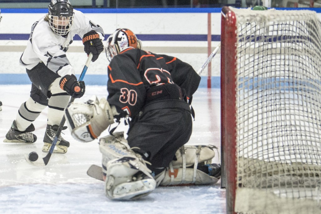 Kennebec's Tommy Tibbetts (91) puts a shot on Brewer goalie Tyler St. Lawrence (30) in the second period Wednesday at Colby College in Waterville.