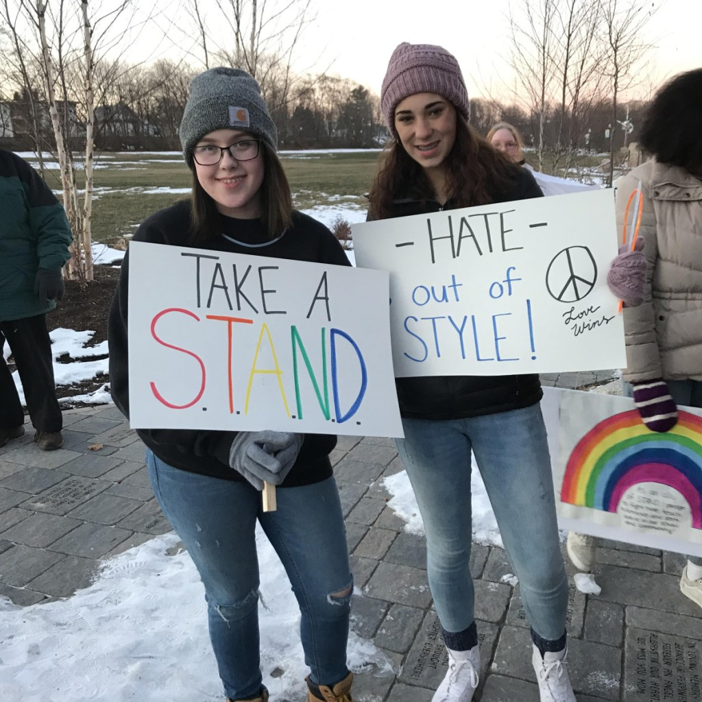 Kira Sencabaugh, left, and Jacie Richard at the Head of Falls after the Taking Action Negotiating Diversity walk for peace and unity in Waterville recently.