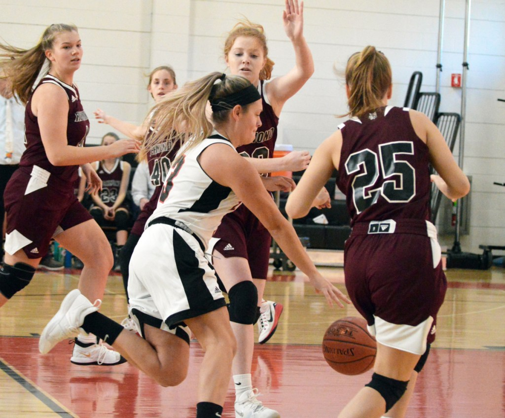 Times Record photo by Bob Conn   Lisbon's Mallory Fairbanks (3) tries to dribble between Richmond defenders Bryanne Lancaster (20) and Caitlin Kendrick (25) in Saturday's MVC game Saturday at Lisbon.