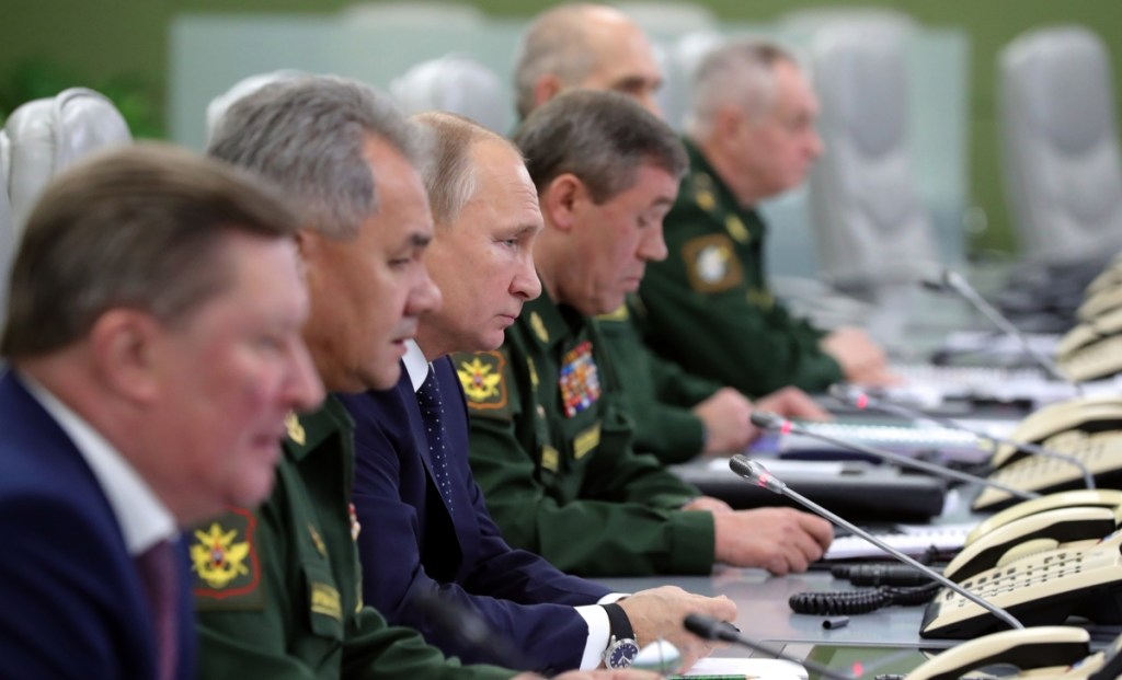 Russian President Vladimir Putin, third from left, observes Wednesday's test launch of the Avangard hypersonic glide vehicle from the Defense Ministry's control room in Moscow. The weapon is said to be impossible to intercept.