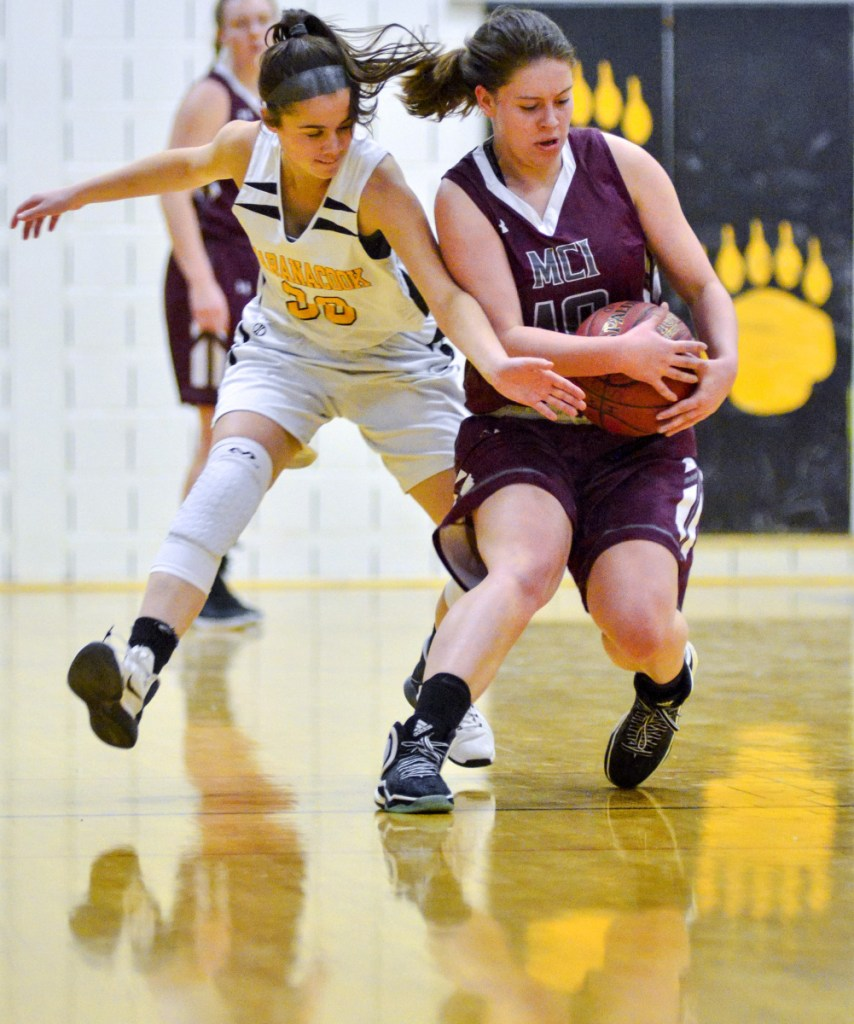 Maranacook's Kaylee Jones, left, and MCI's Sydney Farrar battle for a loose ball during a game Wednesday in the Burbank Memorial Gym in Readfield.