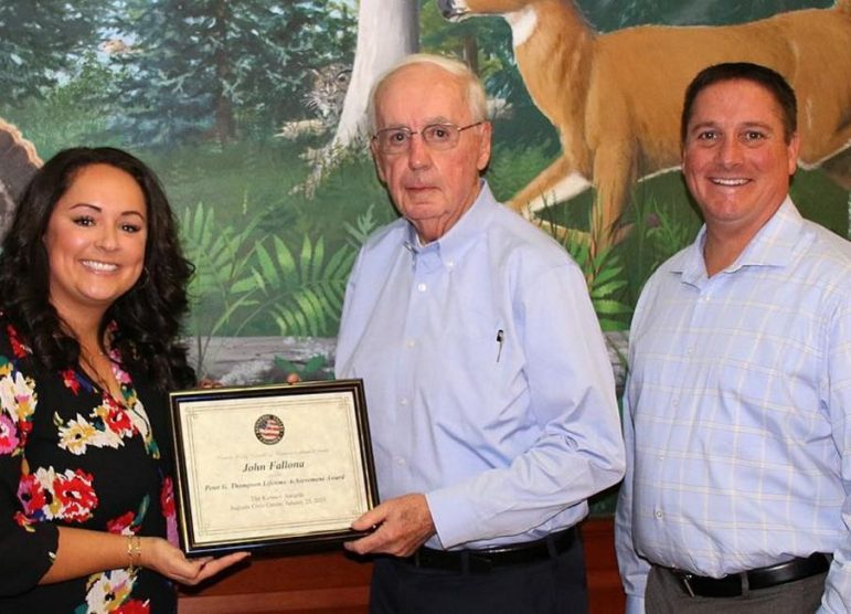 Katie Doherty, president and CEO of the Kennebec Valley Chamber of Commerce, left, and Eric Jermyn, a member of the chamber's board of directors, right, present the Peter G. Thompson Lifetime Achievement Award recently to John Fallona.
