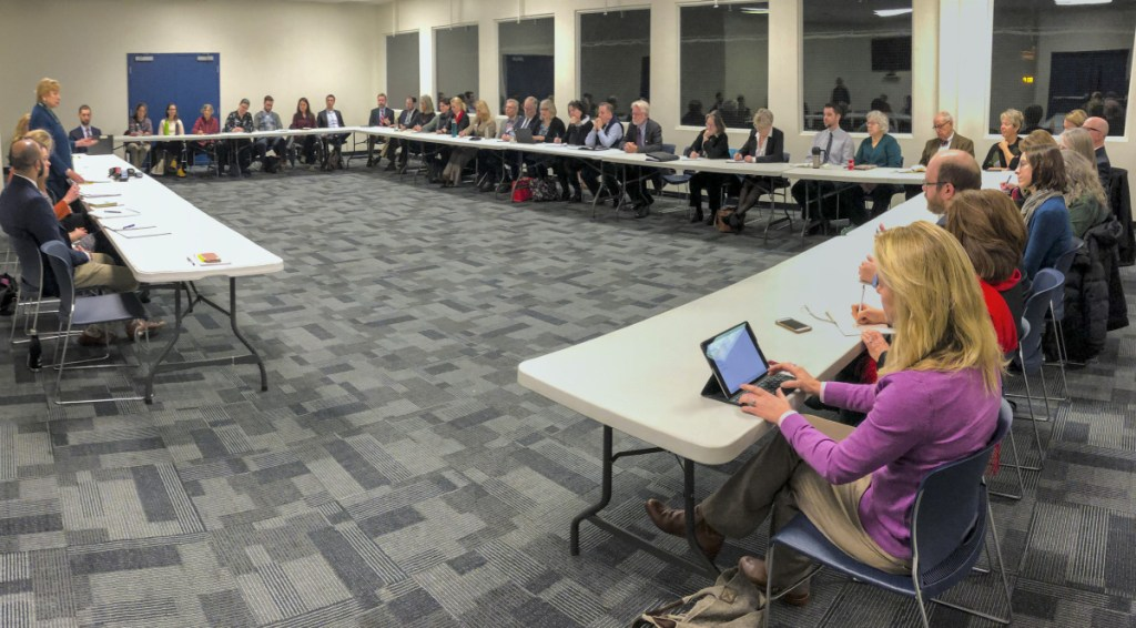 Gov. Janet Mills, standing at left, updates stakeholders about Medicaid expansion in Maine during a discussion Thursday in Hallowell. She said her budget would continue to fund the expansion and would do so without raising taxes in Maine.