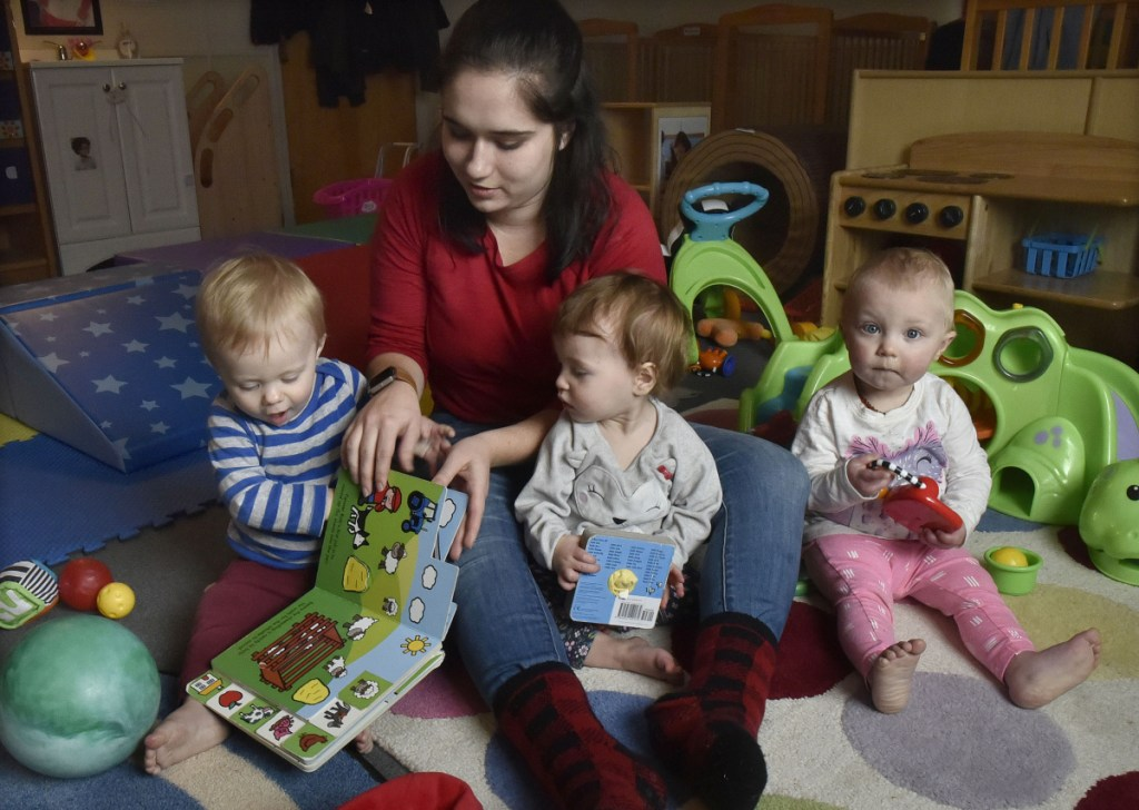 Children's Place assistant teacher Cassidy Brown begins reading to children in the mobile infant room Thursday at the Maine Children's Home for Little Wanderers in Waterville.