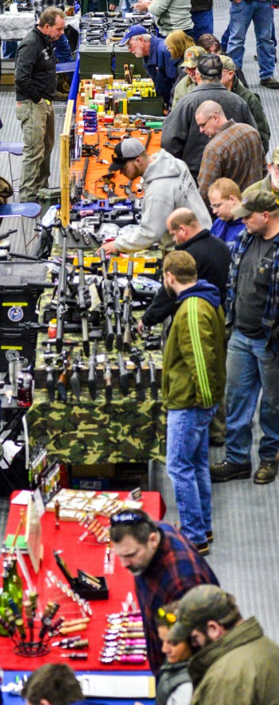 Attendees check out displays during a gun show Saturday at the Augusta Civic Center.
