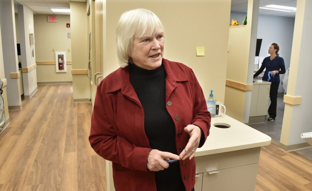 Dr. Barbara Covey, chairman of the board of the Waterville Community Dental Center, said on Wednesday that keeping the center alive in the new and larger facility located in FirstPark in Oakland was critical for the overall health of those who depend on it for their dental needs. At right is dental hygienist Erica Lachance.