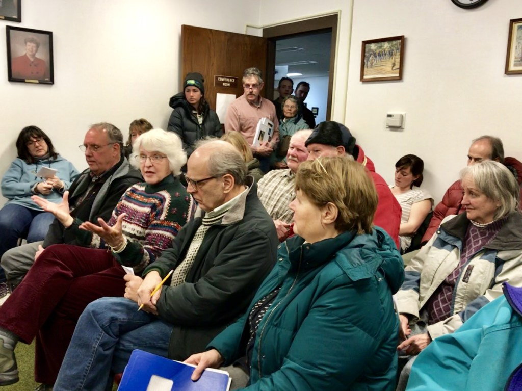 Donna Wheeler, third from left, of Farmington, talks on Tuesday about her opposition to the New England Clean Energy Connect project during a Farmington Board of Selectmen's meeting.