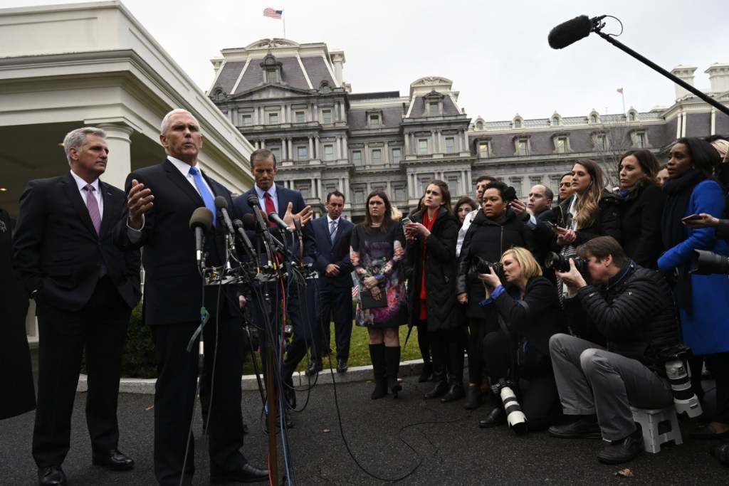 Vice President Mike Pence, second from left, standing with House Minority Leader Kevin McCarthy of Calif., left, and Sen. John Thune, R-S.D., third from left, answers a question after a meeting with President Trump and Democratic leaders at the White House on Wednesday.