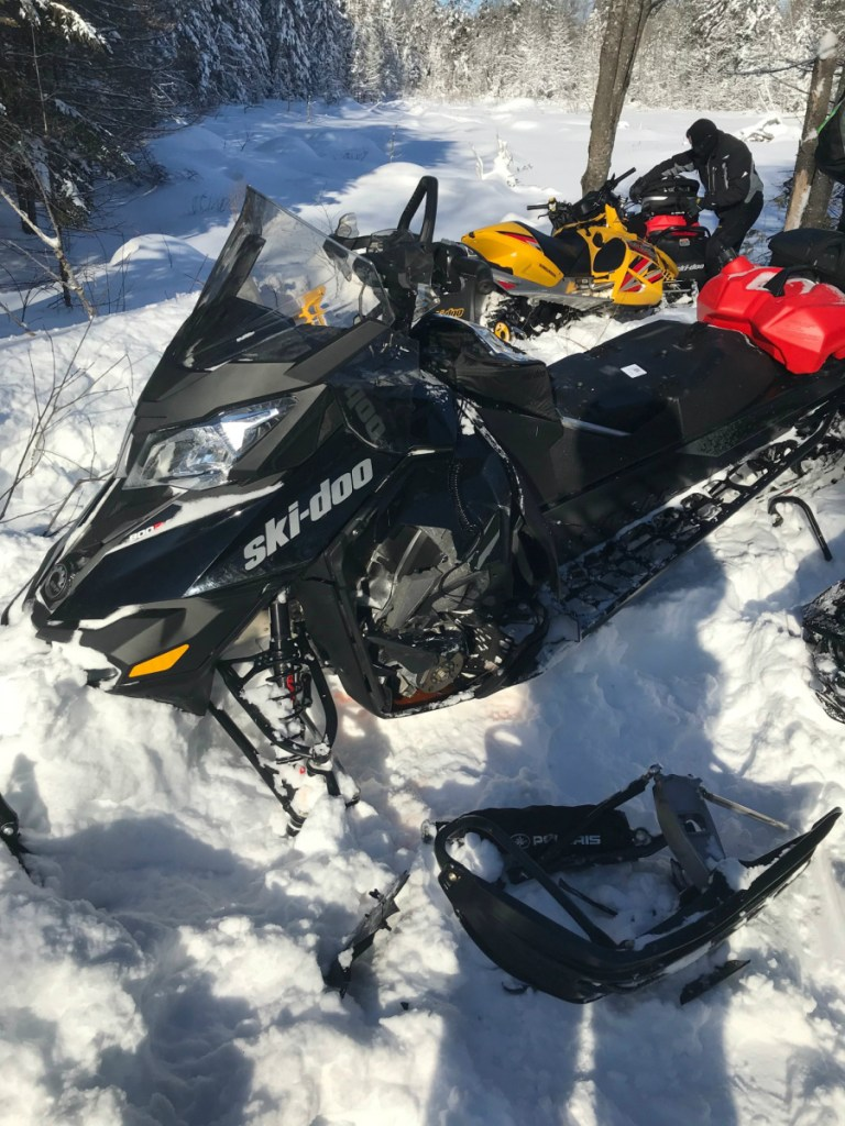 Two snowmobiles traveling in different directions collided nearly head-on Friday, injuring a 15-year-old boy and Michael Byram, 46, from Hermon.
