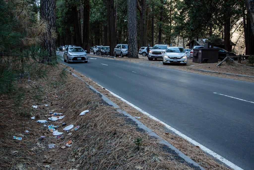 A road is lined with trash in Yosemite National Park, Calif.