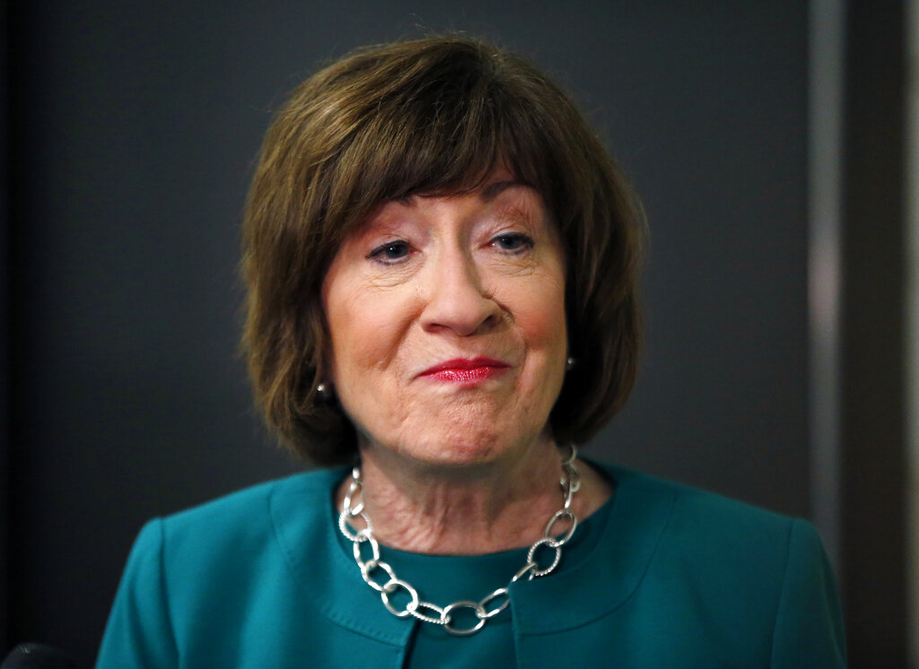 In this Sept. 21, 2018, file photo, U.S. Sen. Susan Collins, R-Maine, speaks to news media at Saint Anselm College in Manchester, N.H. Democrats are eager to unseat Collins. Critics are still incensed over the prominent centrist's vote for Supreme Court nominee Brett Kavanaugh and are angry over the government shutdown. They say she has veered to the right and are no longer confident she'll stand up to President Donald Trump.