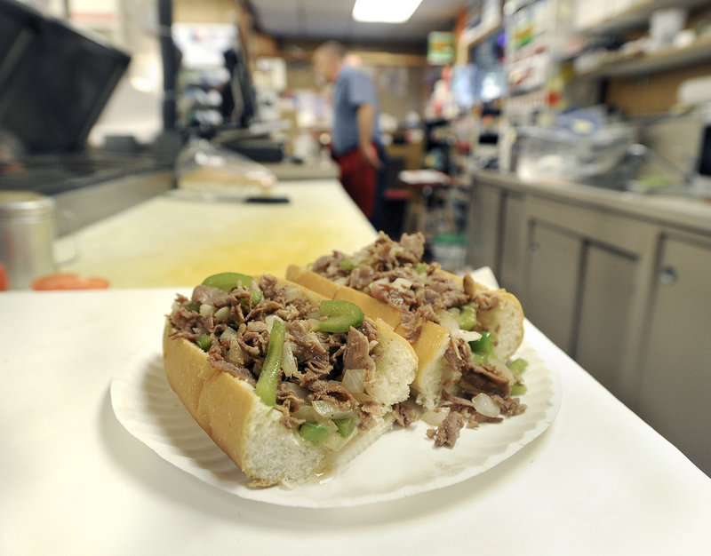 Over the years, the Mellen Street Market has served such items as a steak and cheese sub, shown in this 2014 photo. The market plans to add a cafe.