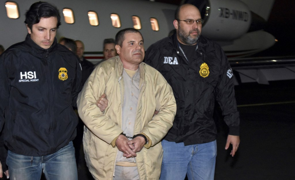 "U.S. law enforcement officers escort Joaquin ""El Chapo"" Guzman from a plane at Long Island MacArthur Airport, in Ronkonkoma, N.Y. Prosecutors made closing arguments in the 12-week trial on Wednesday."