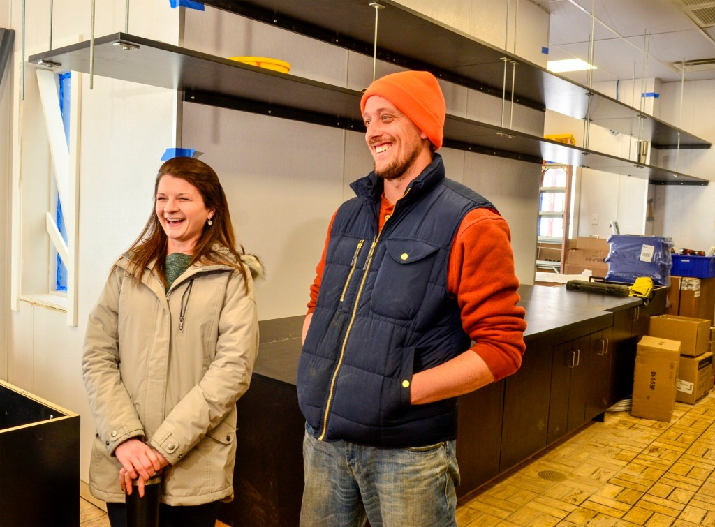 Kennebec Journal photo by Joe Phelan Jessica Pray, left,  and Steve Pracher at the Aroma Joe's under construction on Jan. 31 in Augusta.