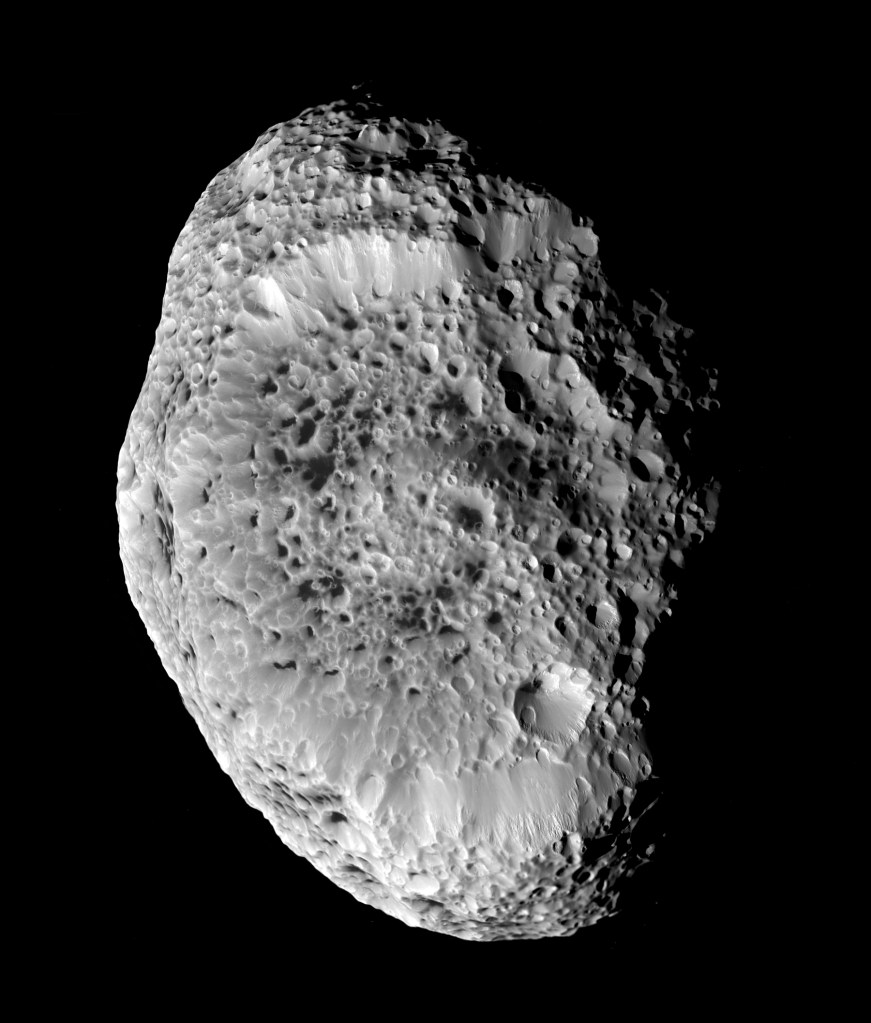 Saturn's impact-pummeled moon Hyperion stares back at NASA's Cassini in this six-image mosaic taken during the spacecraft's close approach on Sept. 26, 2005.