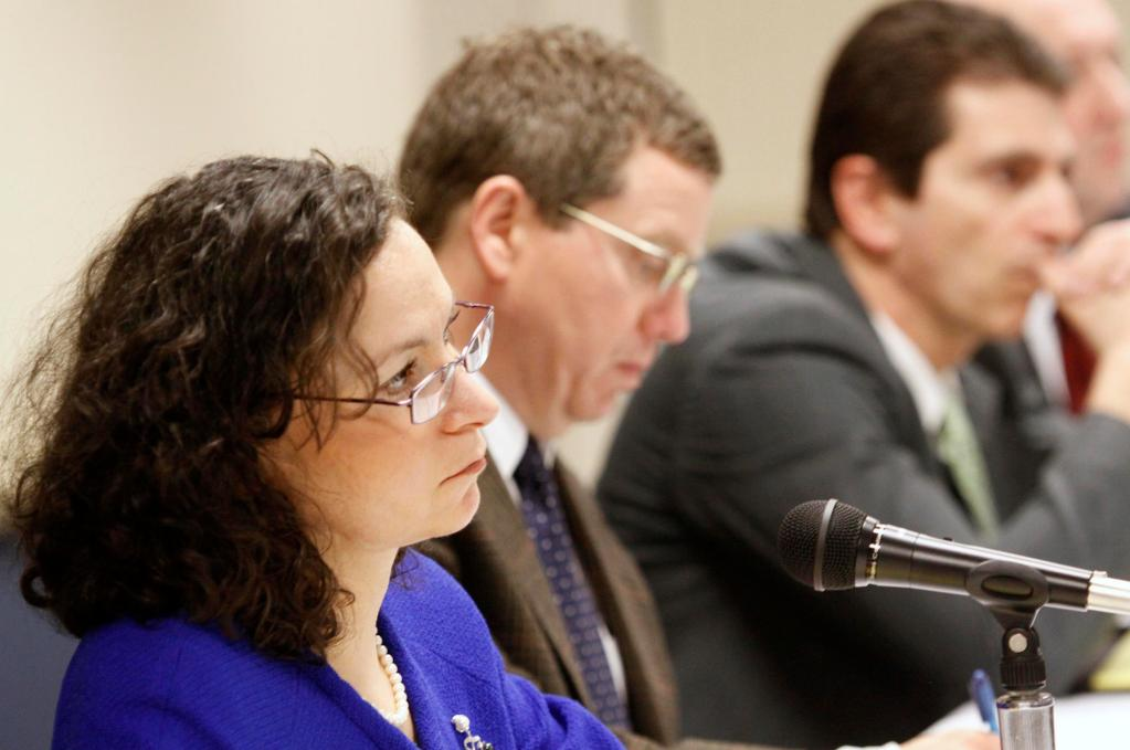 Mila Kofman, Maine's superintendent of insurance, listens to concerns during a public hearing on Anthem's request for a 23 percent premium increase for individual policies at a hearing in Augusta on Monday.
