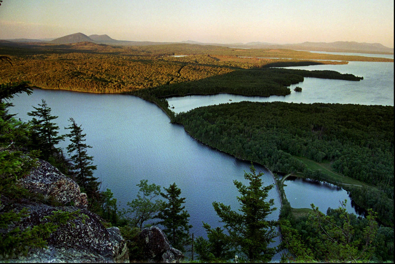 Undeveloped forestland extends from the eastern shore of Moosehead Lake north of Greenville in this summertime photo.